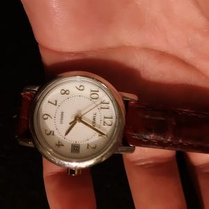 Timex with a burgundy leather band